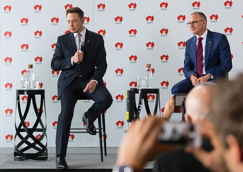 South Australian Premier Jay Weatherill (R) and Tesla Chief Executive Officer Elon Musk listen to a question during an official ceremony in Adelaide, Australia July 7, 2017. (Reuters Photo)
