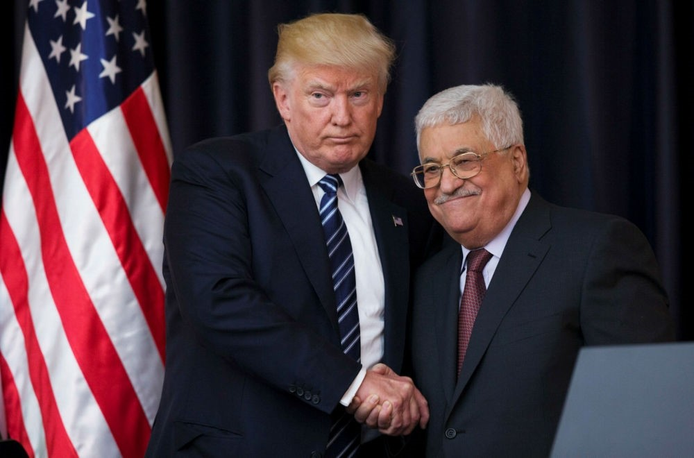U.S. President Donald Trump shakes hands with Palestinian President Mahmoud Abbas after they held a joint press conference at Abbas' residence in Bethlehem, the West Bank, May 23.