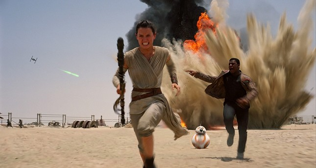 This photo provided by Disney shows Daisey Ridley as Rey, left, and John Boyega as Finn, in a scene from the new film, Star Wars: The Force Awakens. (Film Frame/Disney/Lucasfilm via AP)