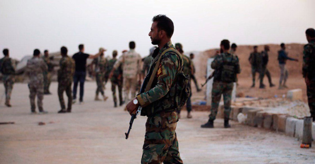 In this Monday, Oct. 14, 2019, photo, released by the Syrian official news agency SANA, Assad regime troops deploy in the Tabqa airbase in Raqqa, Syria. (SANA via AP)