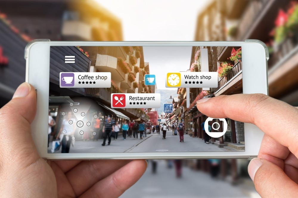 Instead of generating an entirely virtual world accessed by a headset like in virtual reality, AR uses the real world as the background and overlays it with digitally-generated images.