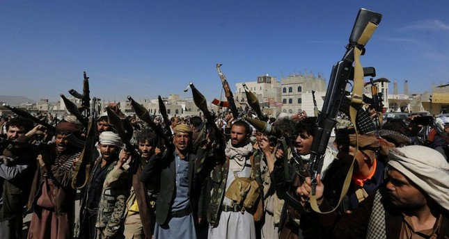 Houthi supporters hold weapons, aiming to mobilize more fighters, in Sana'a, Yemen, Nov. 24.