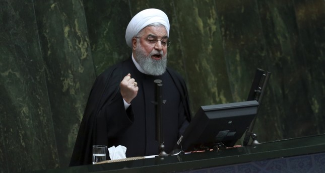Iranian President Hassan Rouhani speaks as he submits next year's budget bill to parliament in Tehran, yesterday.