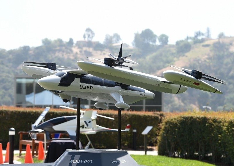 A model of Uber's electric vertical take-off  and  landing vehicle concept (eVTOL) flying taxi is displayed at the second annual Uber Elevate Summit, on May 8, 2018  (AFP File Photo)