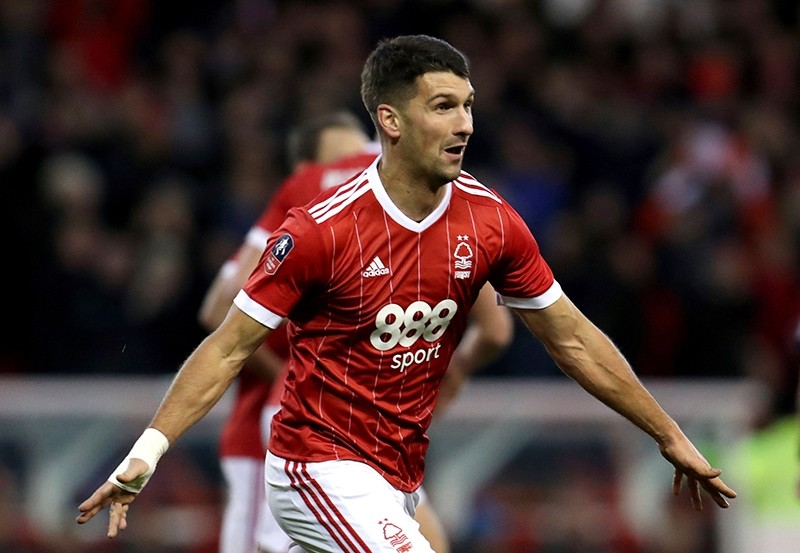 Nottingham Forest's Eric Lichaj celebrates scoring his side's first goal of the game during the English FA Cup, Third Round soccer match between Nottingham Forest and Arsenal at the City Ground, Nottingham, England, Jan. 7, 2018. (PA via AP)