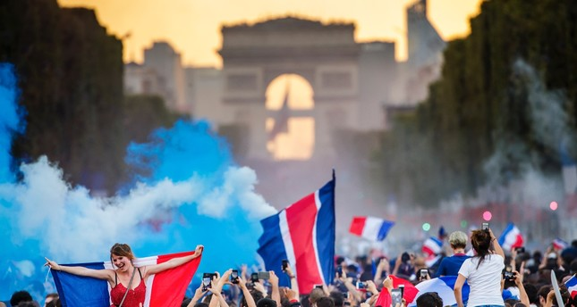 French  supporters celebrate their team's victory on the Champs Elysees.