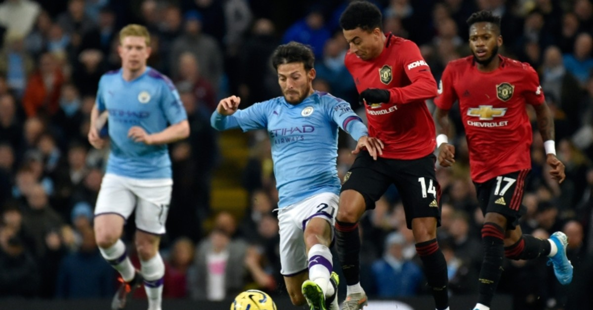 Manchester City's David Silva, center left, duels for the ball with Manchester United's Jesse Lindgard during the Premier League soccer match between Manchester City and Manchester United at Etihad stadium in Manchester, Dec. 7, 2019. (AP Photo)