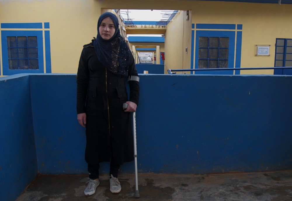 Fida Hassan poses with her new prosthetic leg in the camp she stays at in Syria, Feb. 4, 2019.