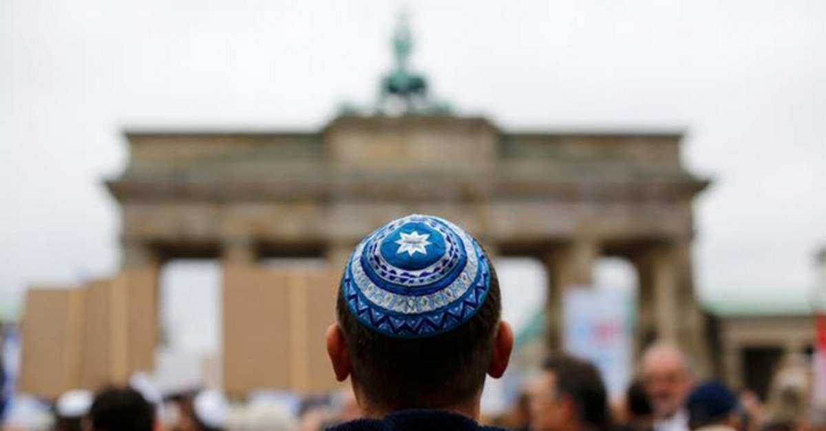 This file photo shows a man wearing a Jewish skullcap in front of Berlin's landmark Brandenburg Gate. (Reuters Photo)