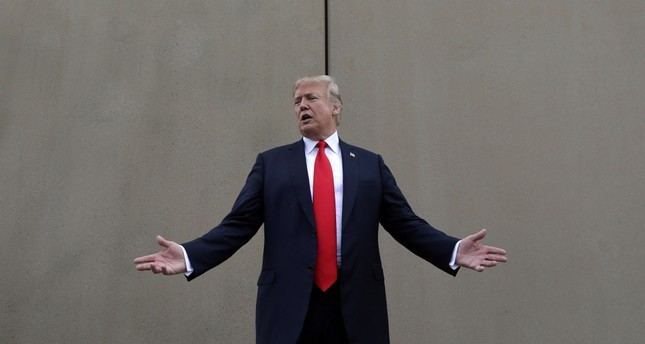 U.S. President Donald Trump speaks during a tour as he reviews border wall prototypes in San Diego, March 13.