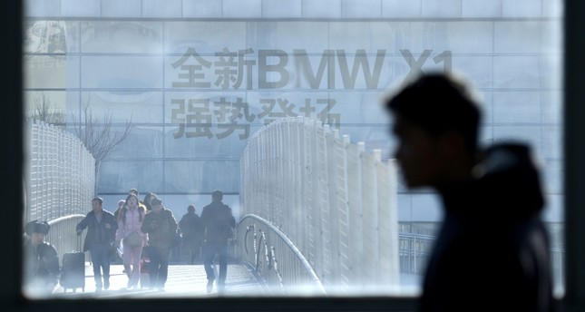 This Dec. 27, 2016 file photo shows an advertisement for German automaker BMW on the building of a BMW store, as seen through a window of a subway station in Beijing, China. (AFP Photo)