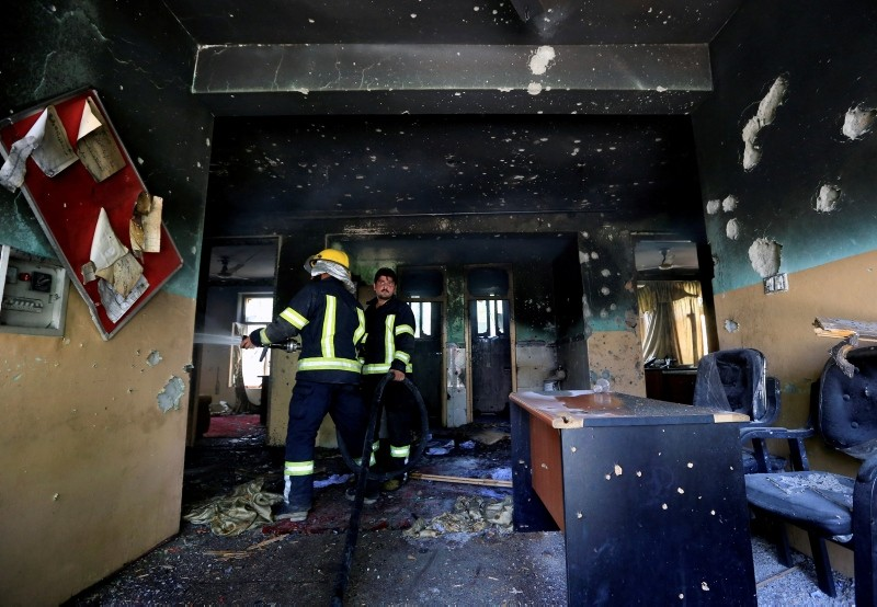 Firefighters spray water inside a building after an attack in Jalalabad city, Afghanistan July 11, 2018. (Reuters Photo)