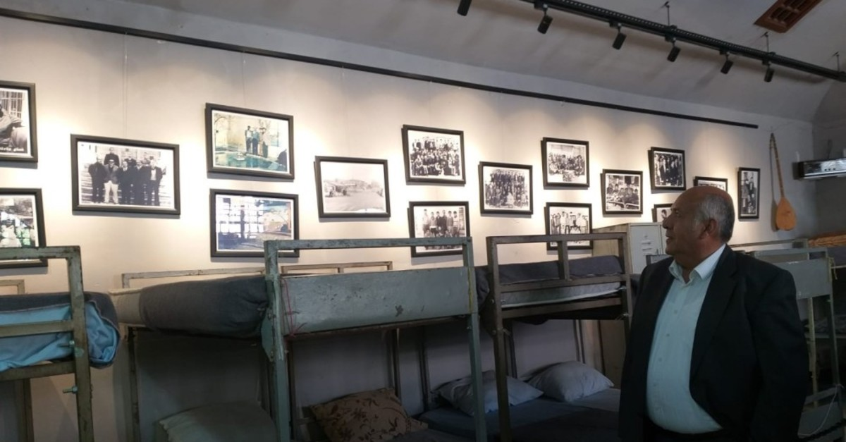 u00d6mer Girgeu00e7 looks at photos of his fellow inmates in a wing of Ulucanlar Prison in Ankara, which was converted into a museum, Sept. 11, 2019.