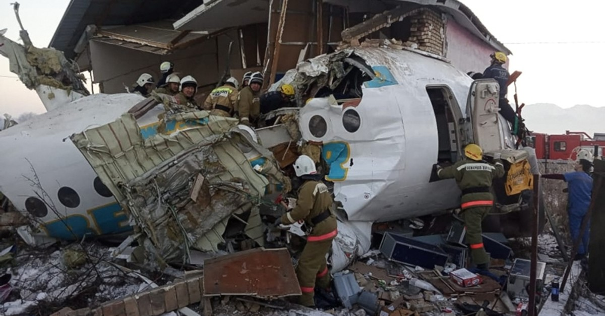 A handout photo made available by the press service of the Committee for Emergency Situations of Kazakhstan (EMERCOM) shows rescuers working at the site of an airplane crash near Almaty airport, Kazakhstan, 27 Dec. (EPA-EFE Photo)