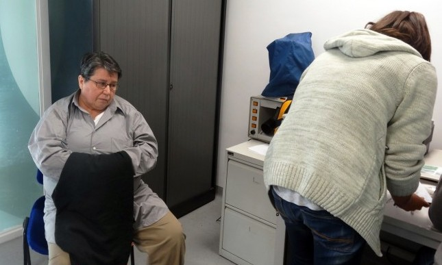 Photo shows Azra Basic, 58, (L), while being processed by a law officer after her arrival at Sarajevo International airport.