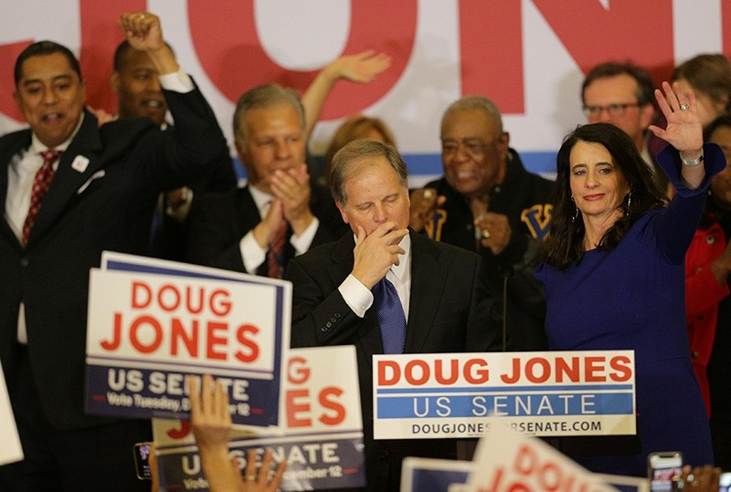 Democratic Alabama U.S. Senate candidate Doug Jones pauses as he addresses supporters while wife Louise (R) acknowledges the audience at the election night party in Birmingham, Alabama, U.S., Dec. 12, 2017. (Reuters Photo)