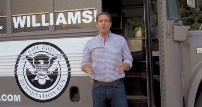 "Michael Williams and his ""Deportation Bus.""(AP Photo)"