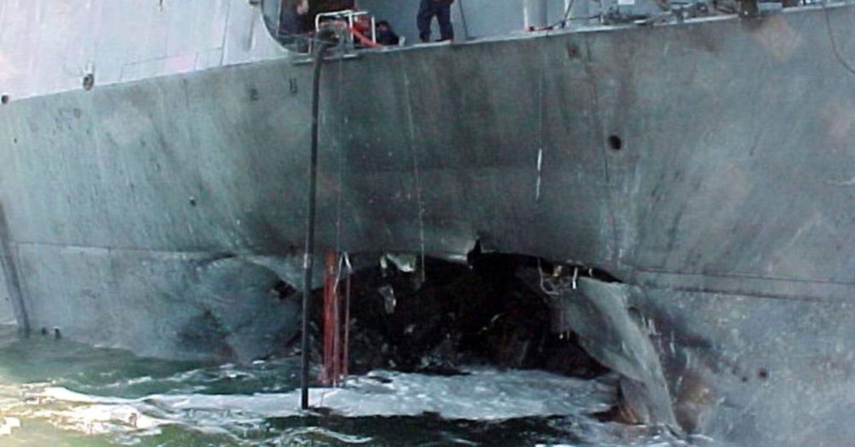 The port side damage to the guided missile destroyer USS Cole is pictured after a bomb attack during a refueling operation in the port of Aden, Oct. 12, 2000. (REUTERS Photo)