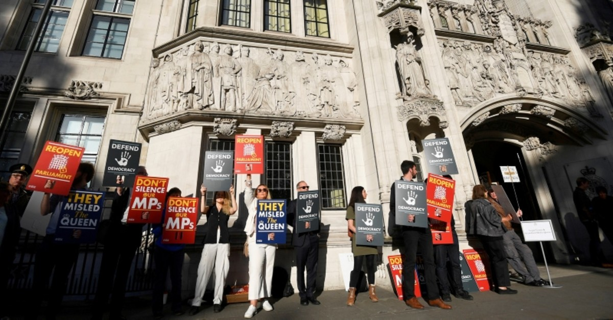 People protest outside the Supreme Court of the United Kingdom against Prime Minister Boris Johnson's decision to prorogue parliament, in London, Britain Sept. 17, 2019. (Reuters Photo)