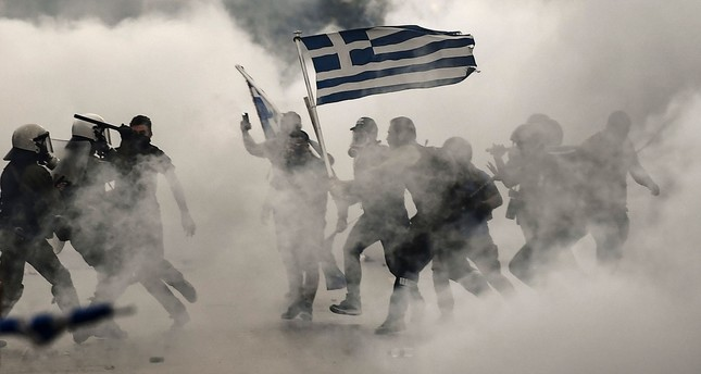 Protesters clash with police during a demonstration against the agreement reached by Greece and Macedonia, Thessaloniki, Sept. 8.