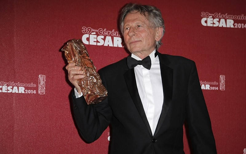 In this Friday Feb. 28, 2014 file picture, Polish-French film director Roman Polanski holds his best director award during the 39th French Cesar Awards Ceremony in Paris, France. (AFP Photo)