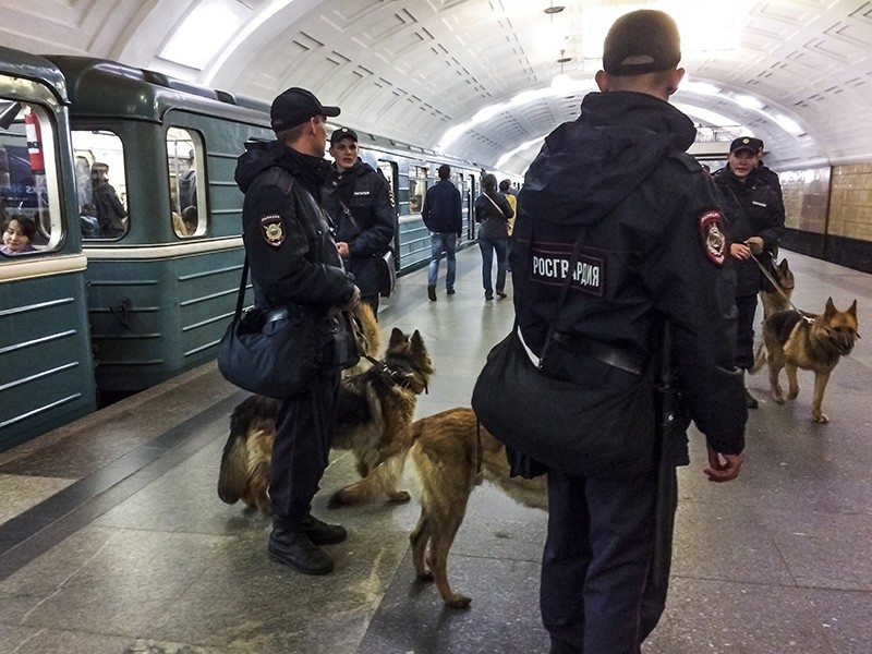 Russian national guard troops patrol in a Moscow subway in Moscow, Russia, Thursday, June 22, 2017. (AP Photo)
