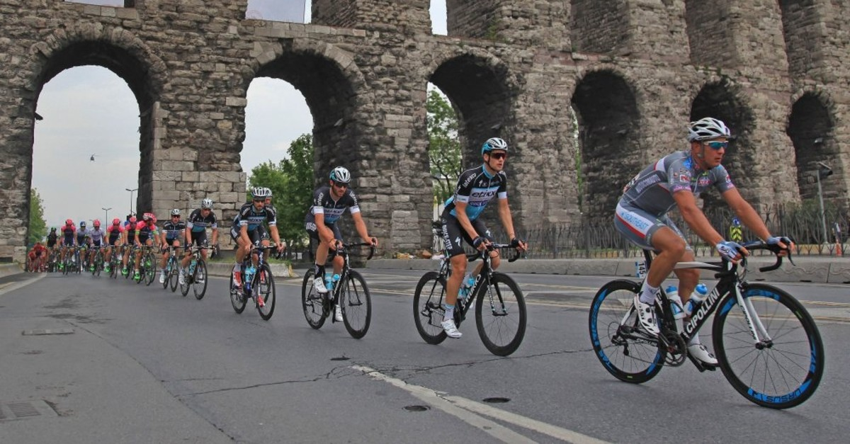 Cyclists ride through Bozdou011fan, an ancient aquaduct in Istanbul, in the 53rd edition of the event, Oct. 15, 2017.