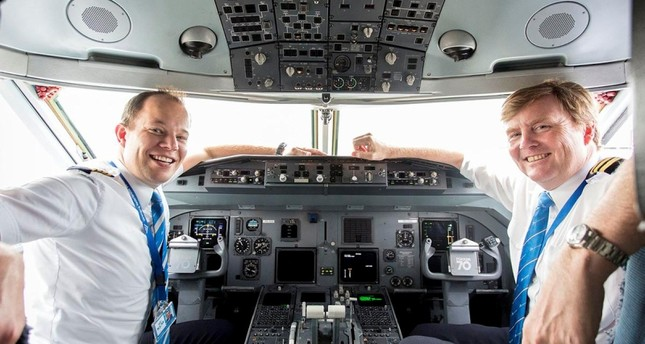 King of the Netherlands Willem-Alexander, right, in the cockpit of a plane. (DHA Photo)