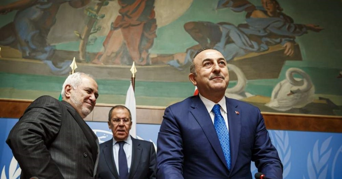From left to right, Iranian Foreign Minister Mohammad Javad Zarif, Russian Foreign Minister Sergei Lavrov and Turkish Foreign Minister Mevlut Cavusoglu leave after a press conference on their Astana Guarantors' Meeting. (EPA Photo)