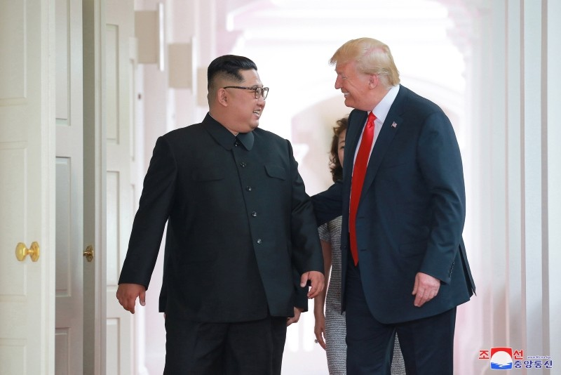 A photo released by the official North Korean Central News Agency (KCNA) shows North Korean leader Kim Jong Un, left, and U.S. President Donald Trump during a summit at Sentosa Island, Singapore, June 12, 2018. (KCNA via EPA)