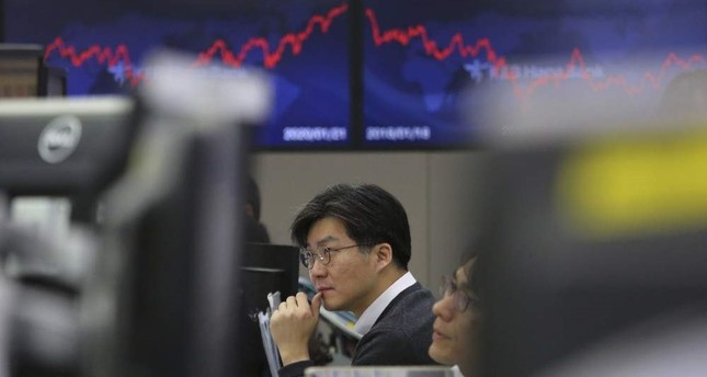 Shares, oil tumble as fears grow over China virus