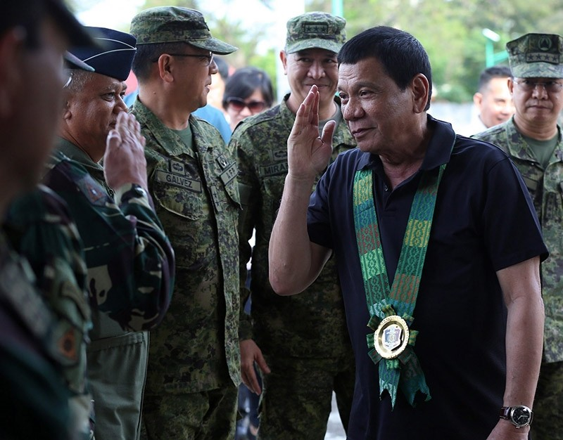 Filipino President Rodrigo Duterte (R) salutes as he meets his military generals at Camp Siongco in the town of Awang, Maguindanao province, southern Philippines on Jan. 28, 2017. (EPA Photo)
