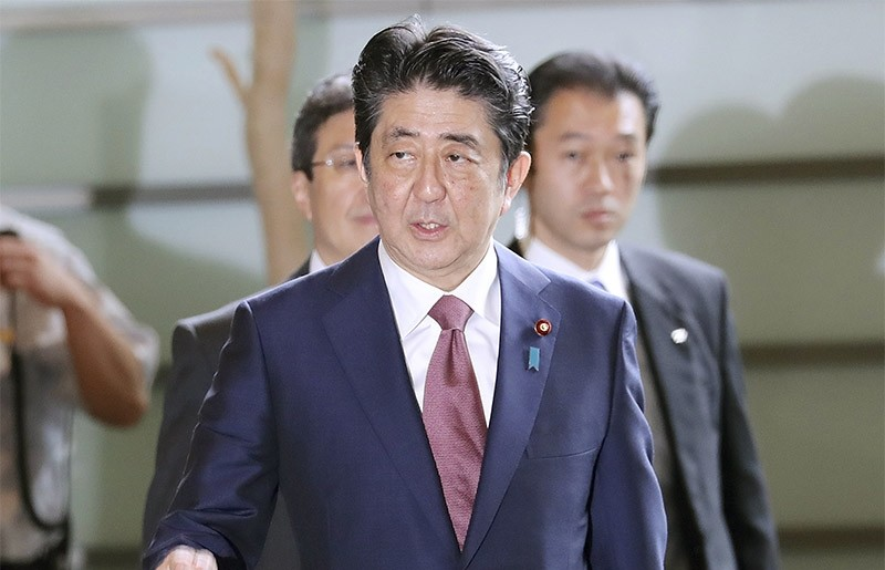 Japan's Prime Minister Shinzo Abe enters his official residence in Tokyo Thursday, Aug. 3, 2017 (AP Photo)