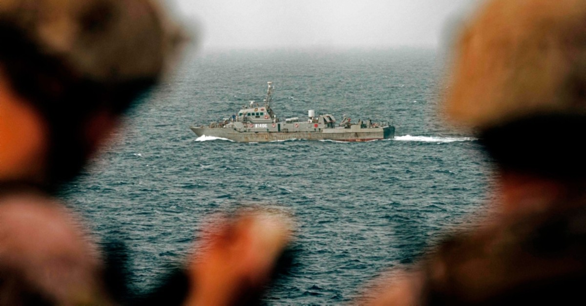 This handout picture taken by the US Navy on August 12, 2019, shows US sailors aboard an amphibious transport dock ship as they keep watch on Iranian fast attack craft in the Strait of Hormuz. (AFP Photo)
