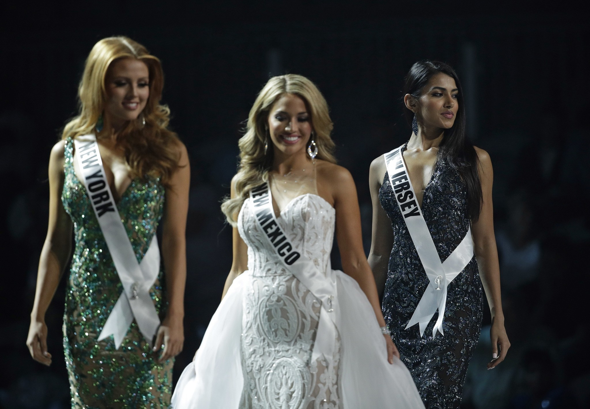 In this May 11, 2017, photo, Miss New Jersey USA Chhavi Verg, right, competes during a preliminary competition for Miss USA in Las Vegas. Very emigrated from India with her parents. (AP Photo)