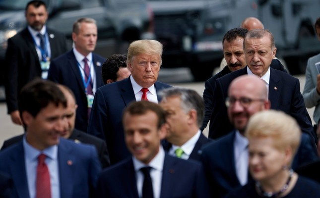 President Recep Tayyip Erdoğan R and U.S. President Donald Trump L follow other leaders for a photo shoot during the NATO summit in Brussels, July 11.