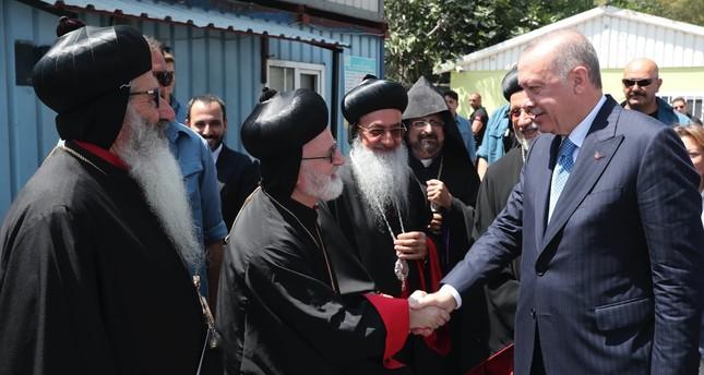 President Recep Tayyip Erdoğan shakes hand with the priests of the Assyrian Orthodox Church during the foundation laying ceremony of Mor Ephrem (Saint Ephraim) Syriac Church in Istanbul, Aug. 16, 2019.
