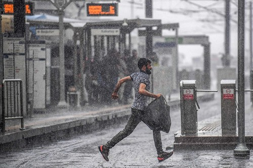A man runs under a heavy rain in Istanbul on Sept. 11, 2018. (AFP Photo)