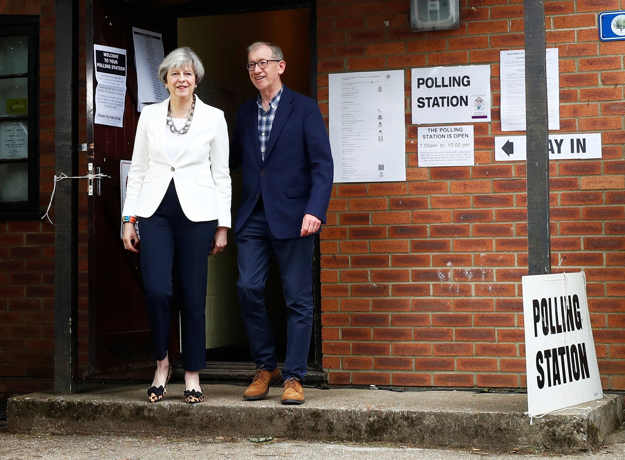 Britain's Primer Minister Theresa May and her husband Philip leave a polling station in Sonning, Britain, June 8, 2017. (Reuters Photo)