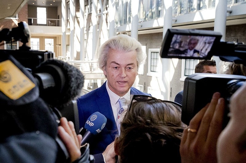 Dutch leader of the far right party Party for Freedom (PVV) Geert Wilders talks to the press (AFP Photo)