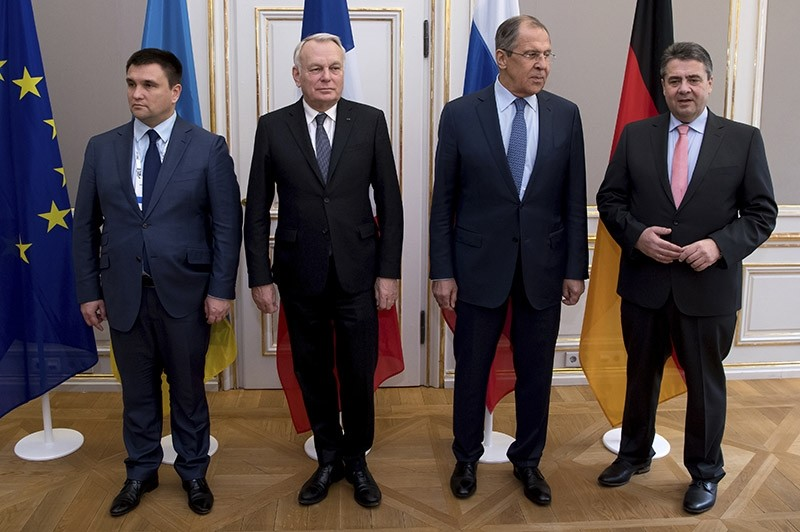 Ukraine foreign minister Klimkin, French foreign minister Ayrault, Russian foreign minister Lavrov, and German foreign minister Gabriel pose for a group photo at Munich Security Conference on Feb. 18, 2017. (AP Photo)