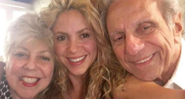 Shakira with her parents.