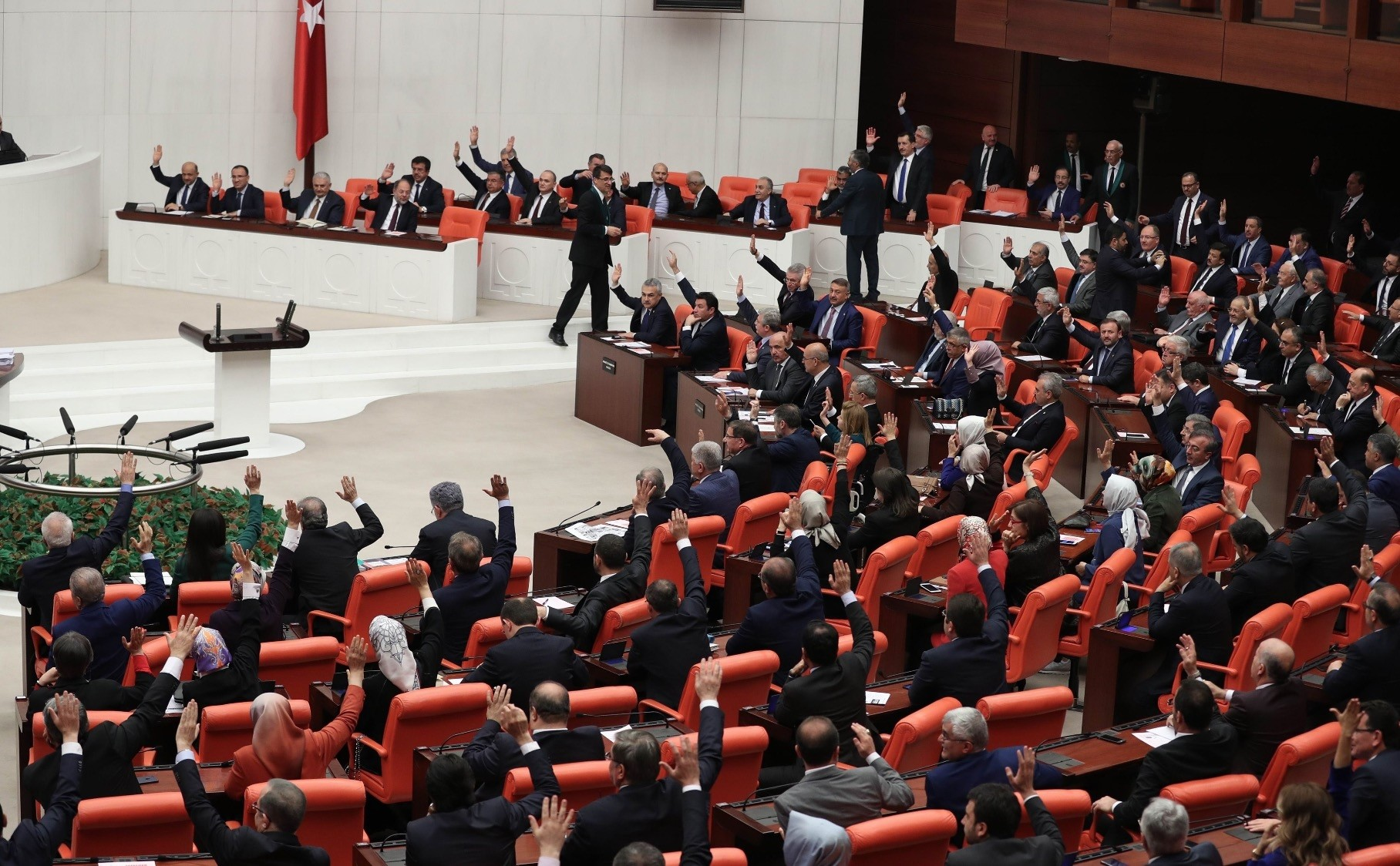 Turkish deputies take part in a vote for the proposed early presidential and parliamentary elections during the general assembly of Parliament, Ankara, April 20.