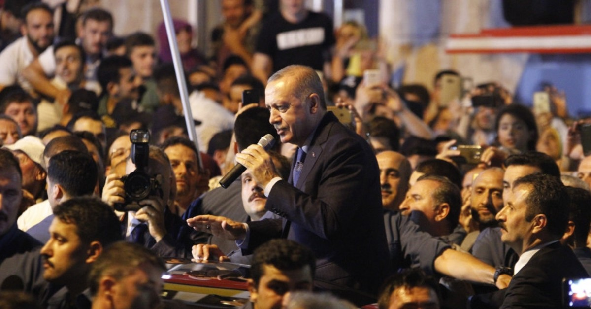 President Recep Tayyip Erdou011fan addresses people in his hometown in the northeastern province of Rize, Aug.10, 2018.