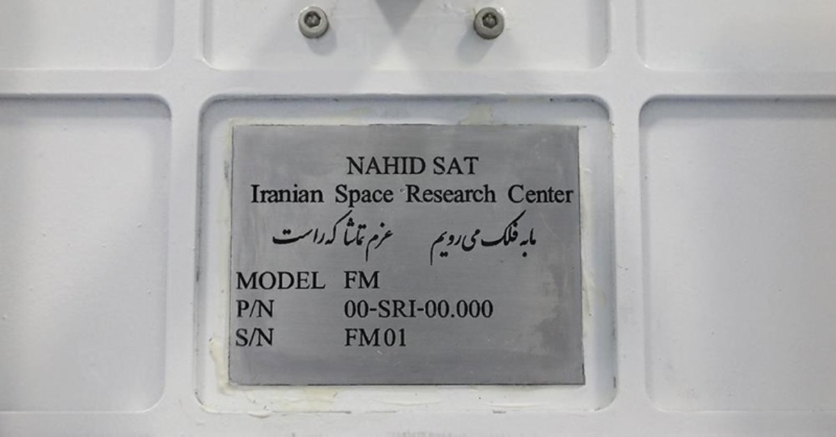 A handout photo made available by Iran's Information and Communication Ministry office on August 31, 2019 shows a view of the plaque on the Nahid-1 domestically-built satellite at the space research centre in Tehran. (AFP Photo)