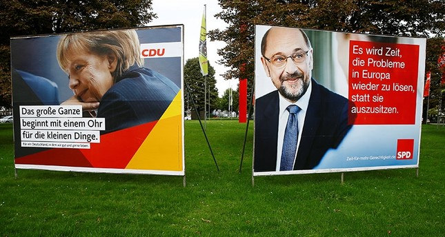Election campaign posters show Angela Merkel, German Chancellor and leader of the Christian Democratic Union party CDU, and Martin Schulz, leader of Germany's Social Democratic party SPD, in Bonn, Germany, September 7, 2017. (Reuters Photo)