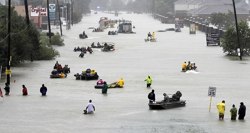 escue boats float on a flooded street as people are evacuated from rising floodwaters brought on by Tropical Storm Harvey on Aug. 28, 2017, in Houston (AP File Photo)