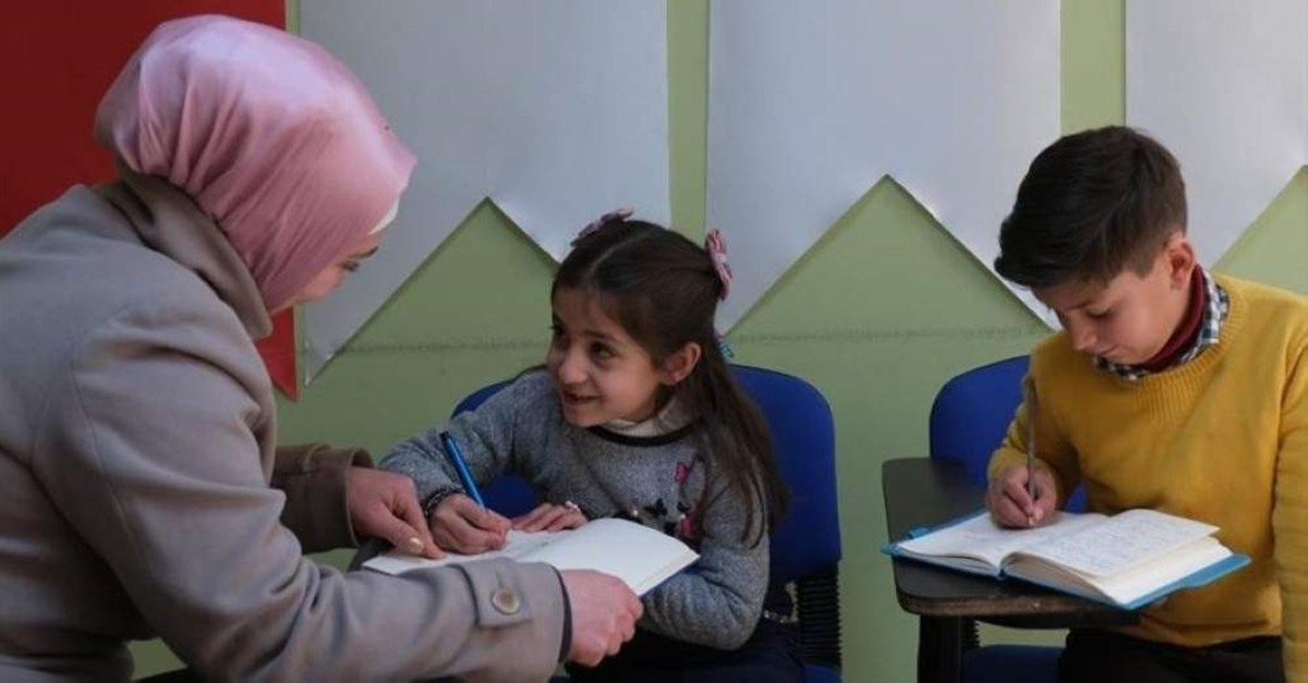 Berra Yunis with her children at the community center in Ankara. (AA Photo)