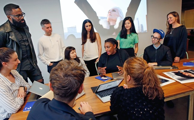 Members of the Droga5 team behind the recent CoverGirl campaign talk during a meeting at the advertising agency's headquarters, in New York.