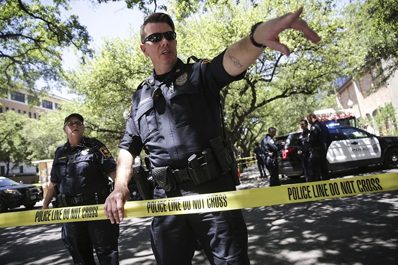 Law enforcement officers secure the scene after a fatal stabbing attack on the University of Texas campus Monday, May, 1, 2017. (AP Photo)